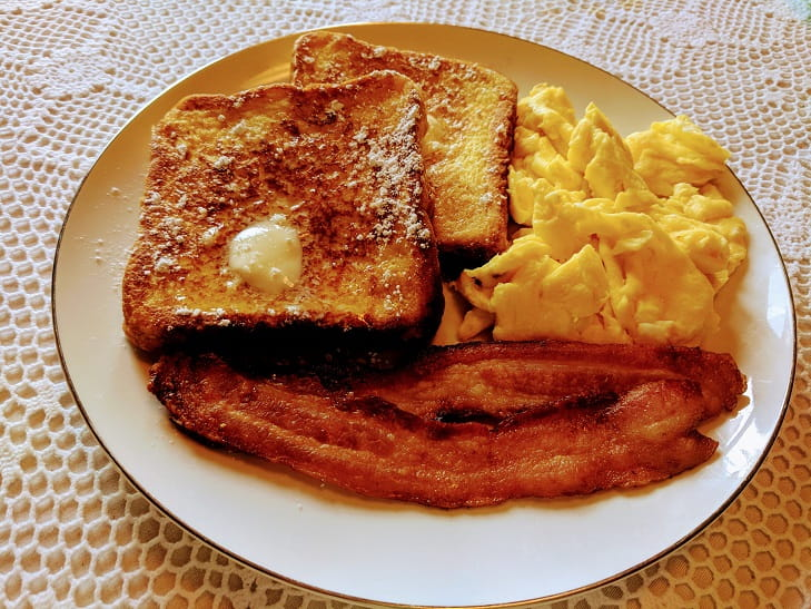 French toast with scrambled eggs and bacon